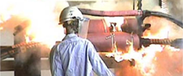 a man watching a fire safety demonstration