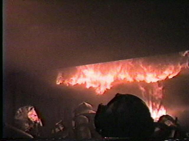Firemen fighting an indoor fire