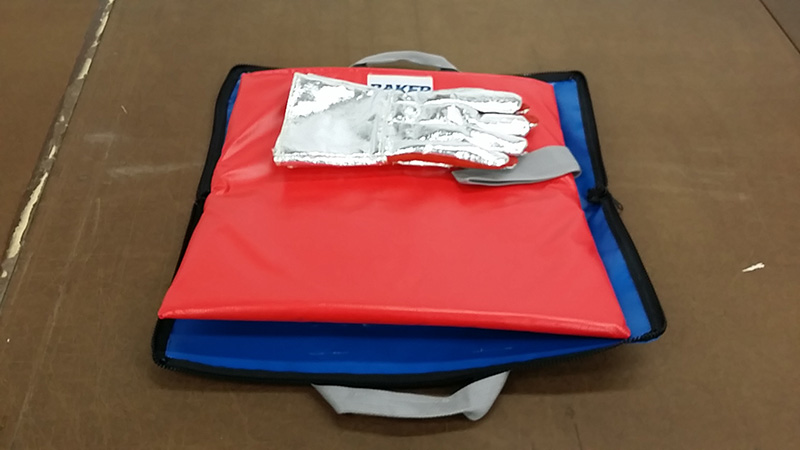 red and blue HOT-STOP L fire containment bags with a pair of silver gloves on top